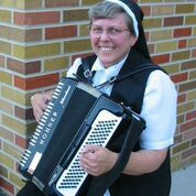 Sr. Elaine on the accordion